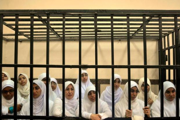 Women defendants at a mass trial of supporters of the Muslim Brotherhood in Alexandria, Egypt, November 2013